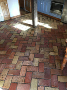 cleaning a brick floor in CB1